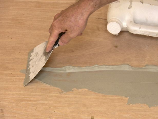 painted subfloors | spread self leveler compound over plywood