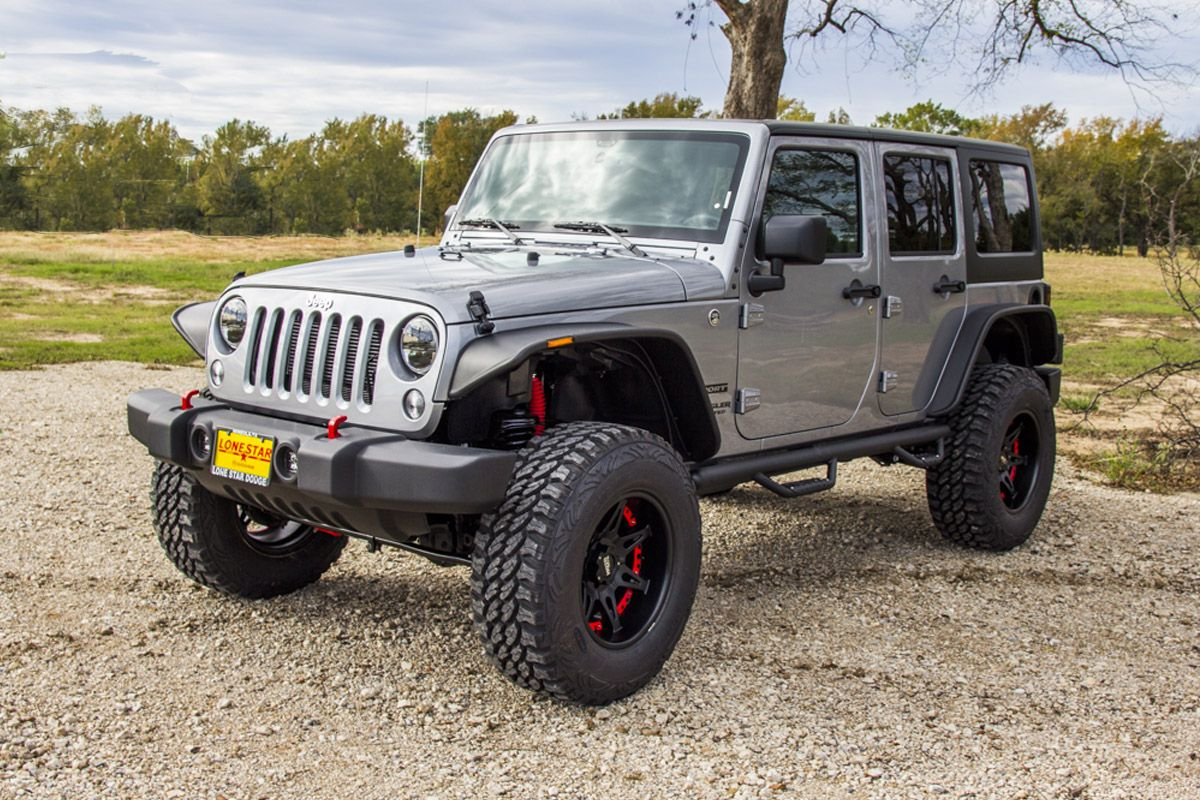This Custom Jeep Wrangler Unlimited Sport Features A 4 Inch Lift Kit,  Custom Wheels And Tires, Flat Fenders, Led Lights And More.