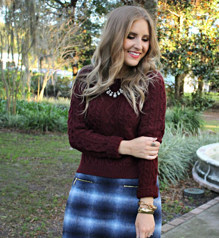 Chic winter look | @ashleynicholas pairs a chunky maroon sweater with a wool plaid skirt | Piperlime