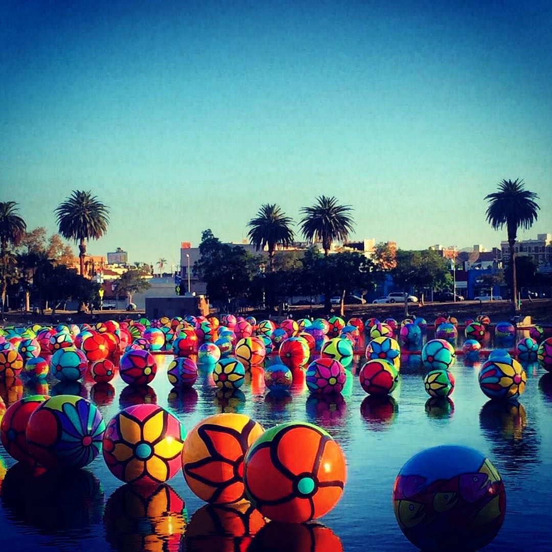 """Giant painted beach balls on the MacArthur Park lake. #LA #Beautiful"""
