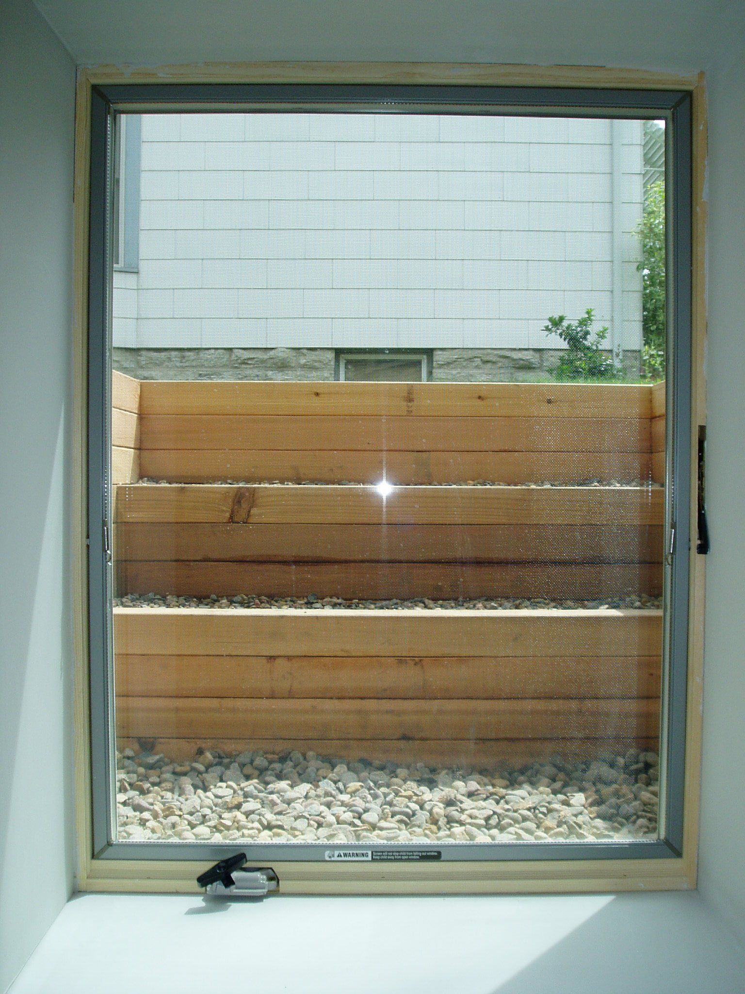 Egress window coverings  project gallery  brenne builders  french drain  pinterest