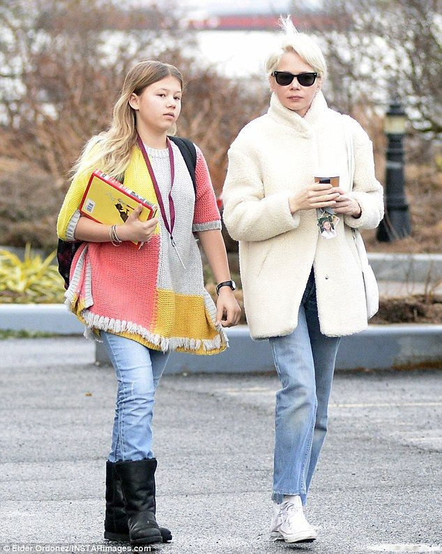 Michelle Williams dons faux fur coat on stroll with daughter Matilda