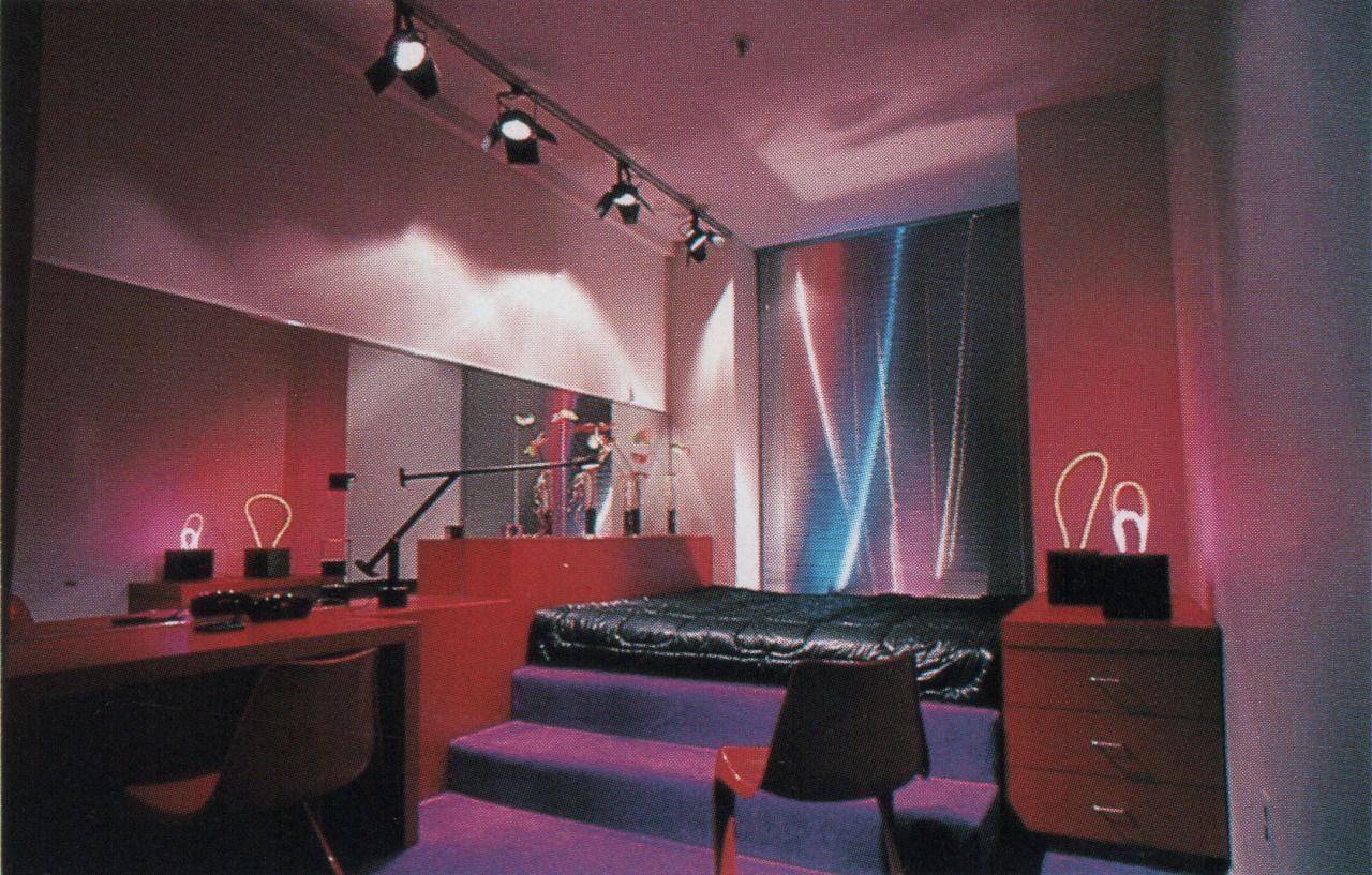 Track lighting freestanding neon art reflective mini blinds purple carpeted