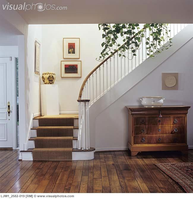 STAIRWAYS: Beige Carpet Runner, Stairway Landing Has A Pedestal With Native  American Coil Basket