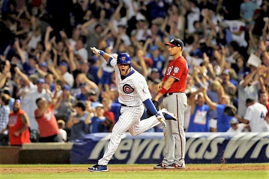 Victory run David Bote of the Cubs celebrates his walk
