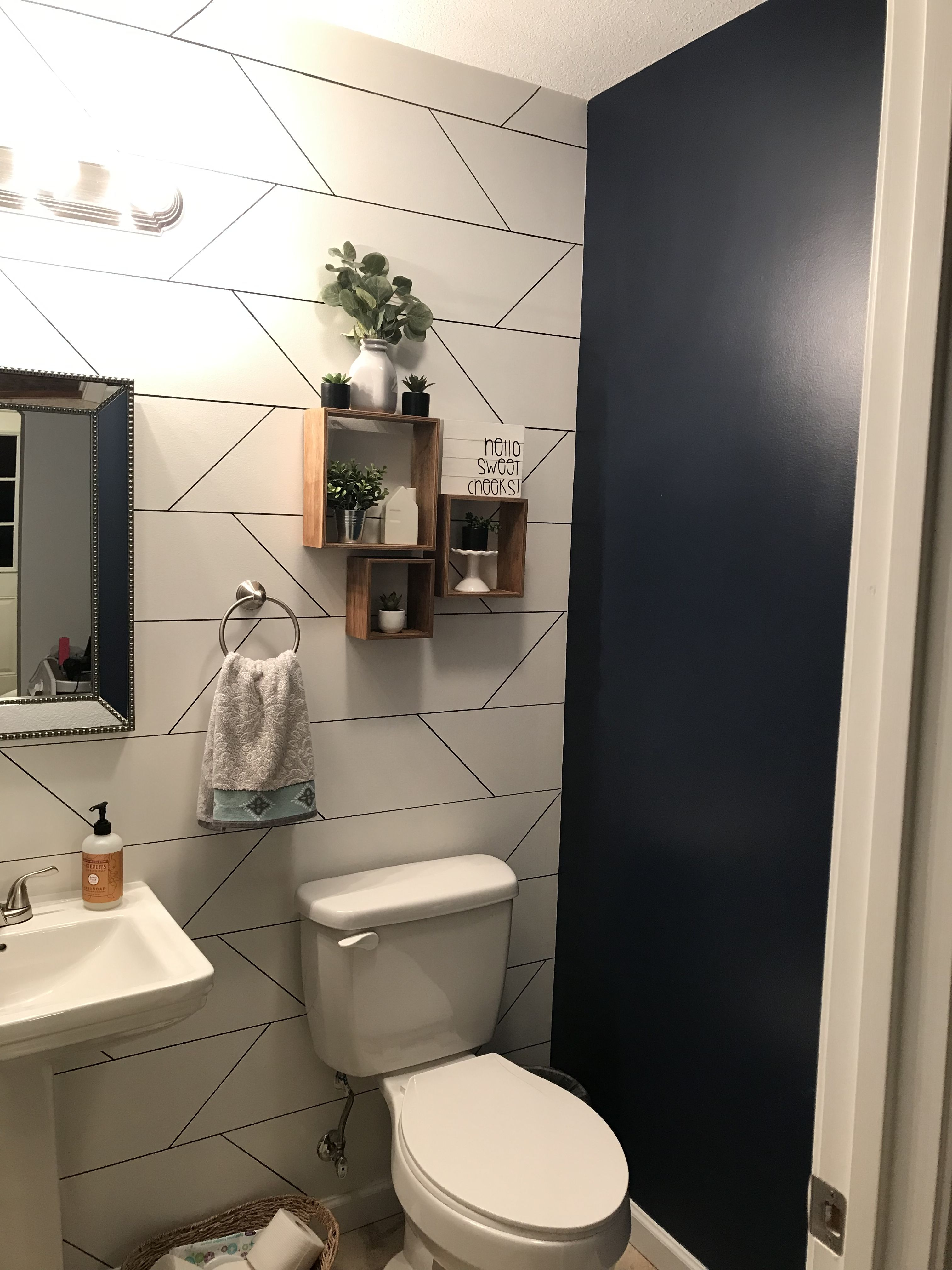 Half Bath With Accent Wall And Navy Paint Bathroom Accent Wall Wallpaper Accent Wall Bathroom Bedroom Wallpaper Accent Wall
