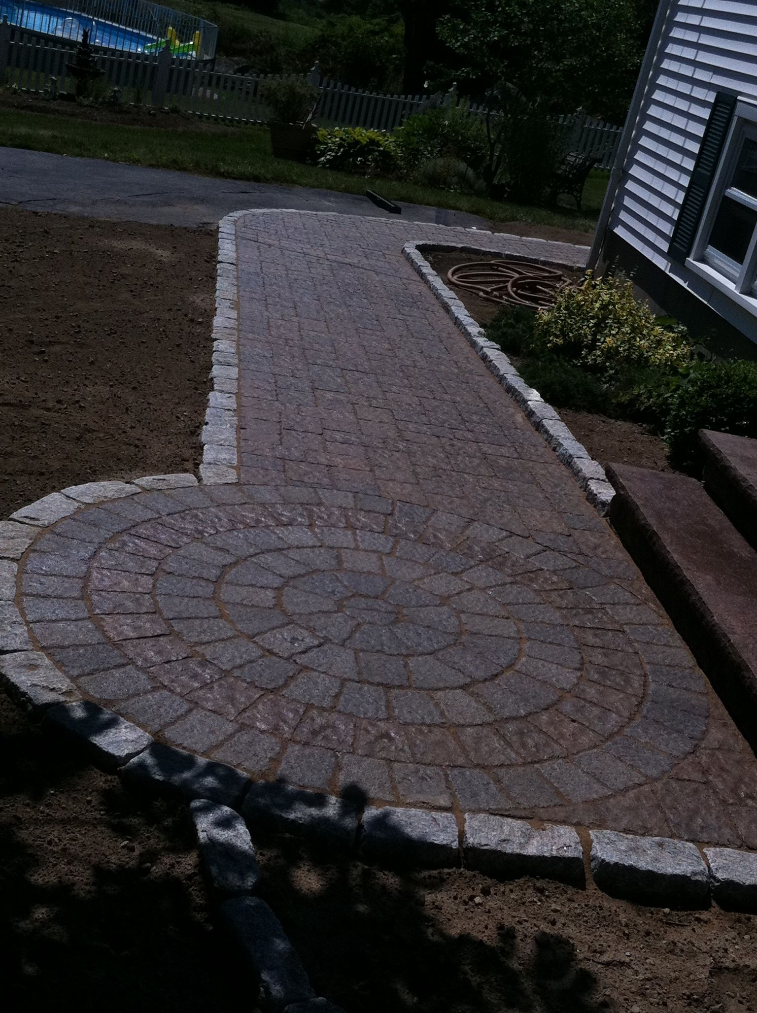 Paver walkway w circle with cobble stone edging by araujo for Gravel path edging ideas