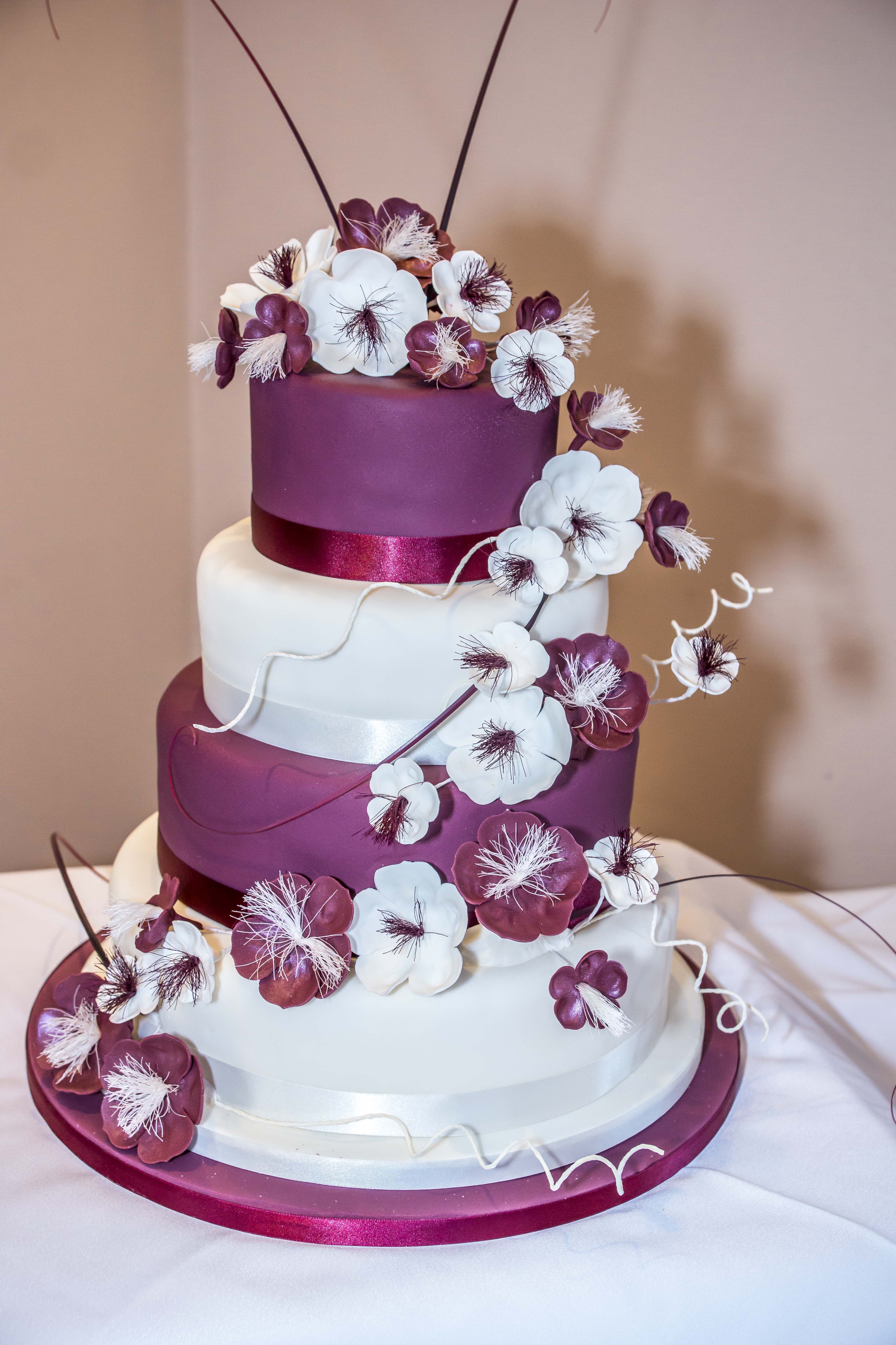 Flowery Wedding cake with a white and burgundy colour scheme.