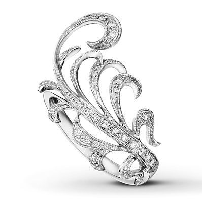 This ring, from the Peter Lam Collection, features an array of dazzling round diamonds in a playful feather design. Fashioned in 18K white gold, the ring has a total diamond weight of 1/5 carat. Diamond Total Carat Weight may range from .18 - .22 carats.