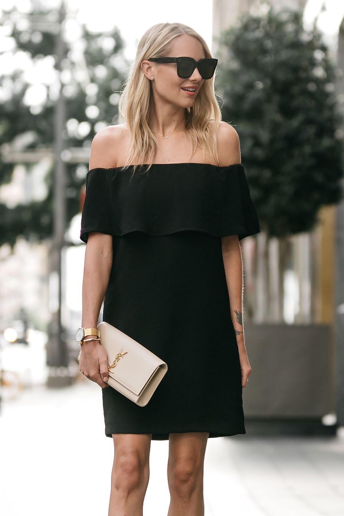 Blonde woman wearing Nordstrom off the shoulder black dress YSL nude ...