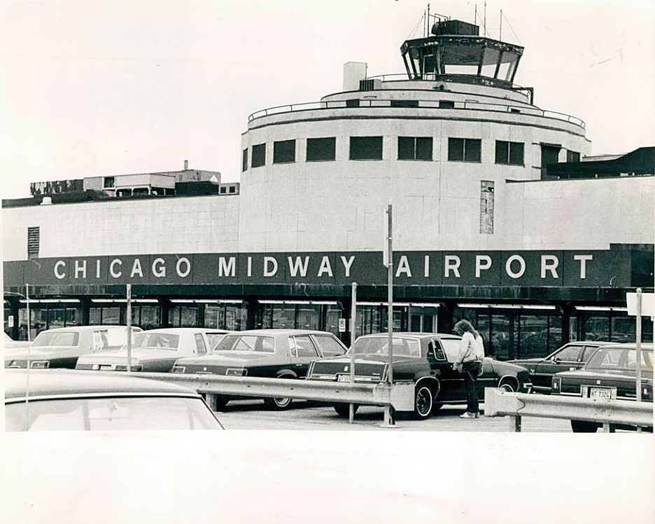 Midway Airport Terminal in Chicago then the busiest airport.  Flights landing over Cicero Avenue.