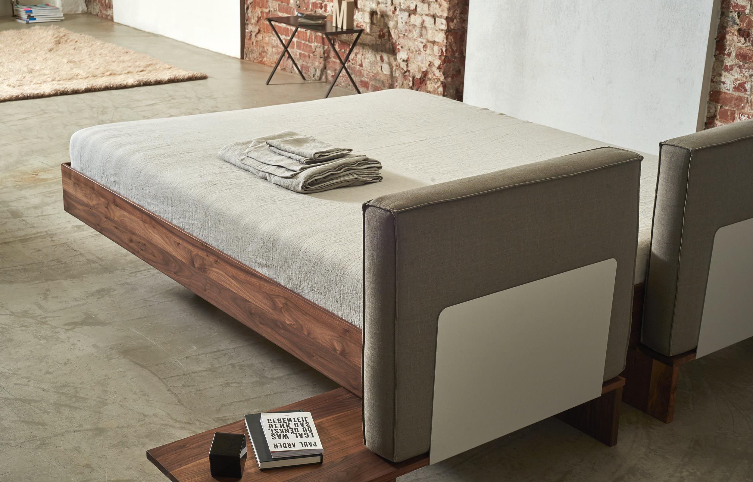 Massivholzbetten design  Bedroom furniture by more. B15 bed presented in walnut with ...