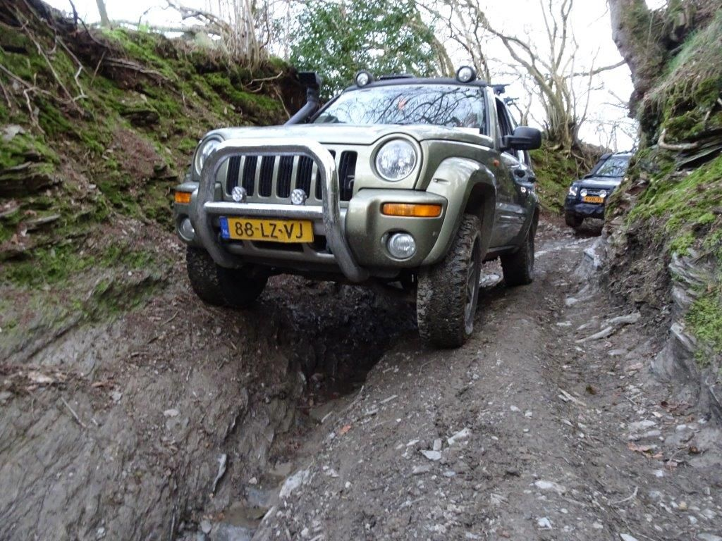 Jeep kj modified winch rock sliders rack with cans plates and high lift jack made by offroadtech helmond holland jeep liberty kj jeep cherokee