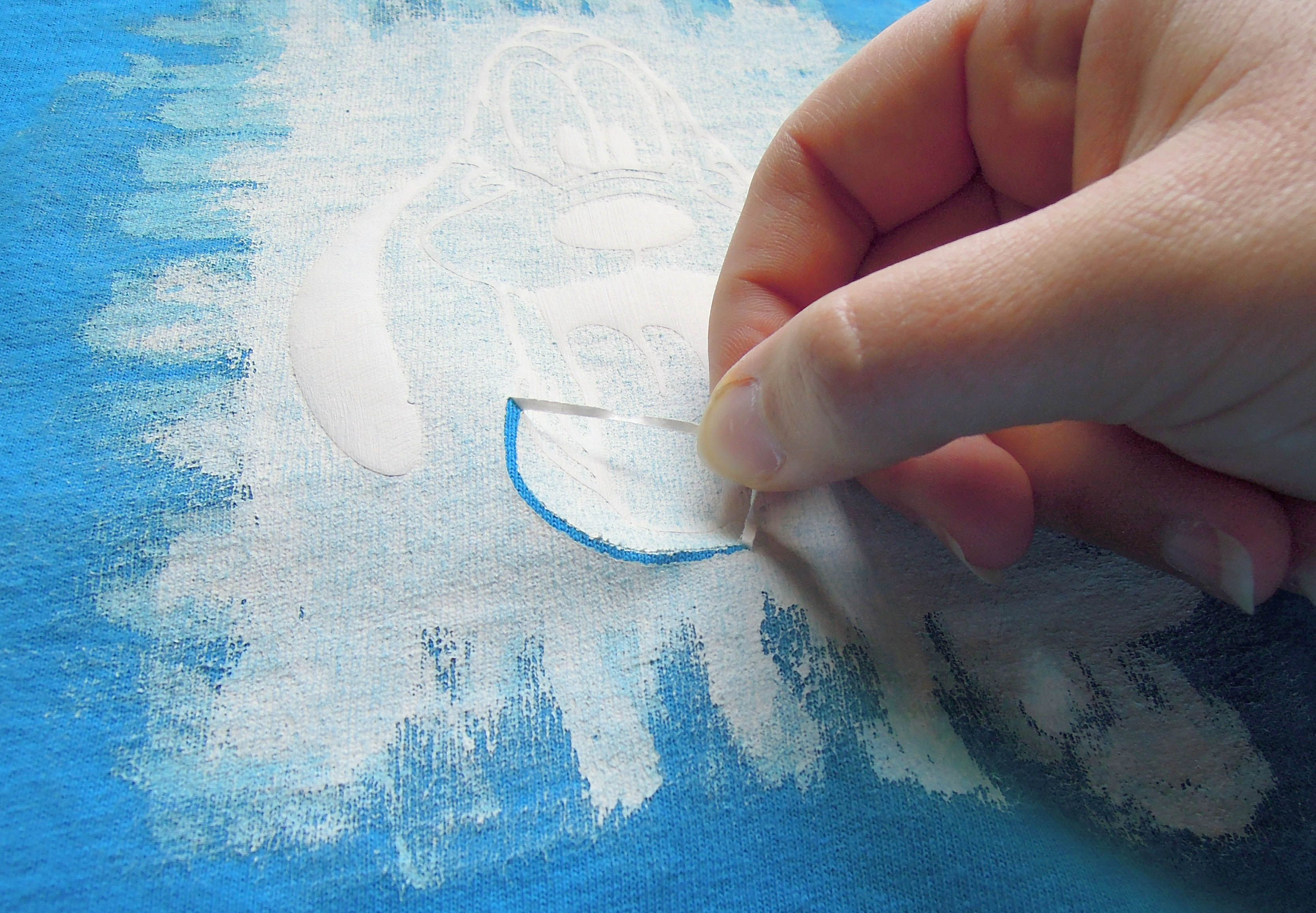 tutorial on stenciling Disney characters using  freezer paper, designs included