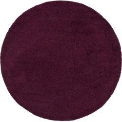 Photo of benuta Shaggy Rug Swirls Purple ø 120 cm round – long pile rug for living room benuta