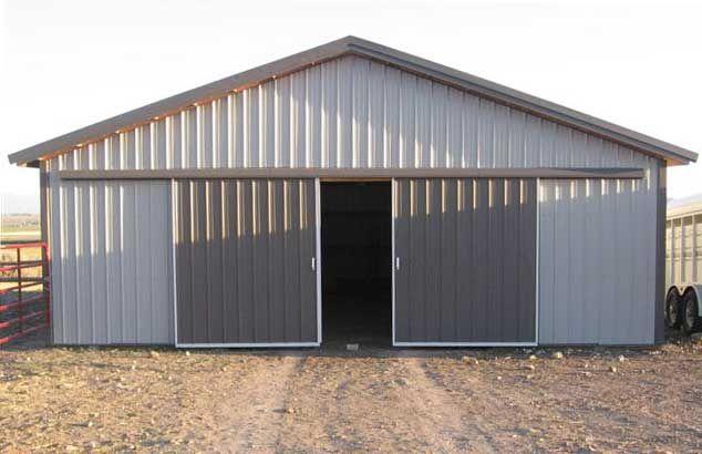10 39 sliding barn doors hansen pole buildings metal for Sliding barn door construction plans