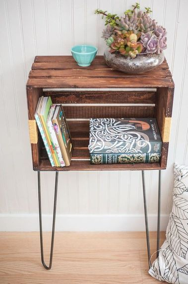 Use a small wooden crate for a DIY bedside table with extra storage space