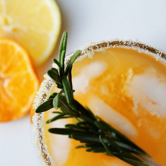 #Winter Sun #Cocktail with #clementine juice, lemon, #vodka and sprig of rosemary