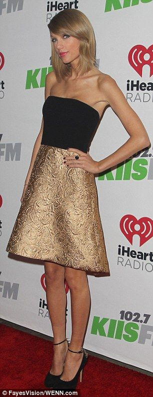 Gorgeous:The 24-year-old looked stunning in a gold brocade skirt and black tube top showcasing her bronzed complexion and lean figure