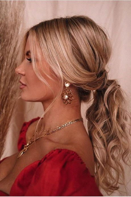 This hairstyle works from day to night, office to cocktail party. Leave out a few wavy tendrils to frame your face, and tease the crown beforehand to add volume. #ponytail #braid #hairstyles #southernliving