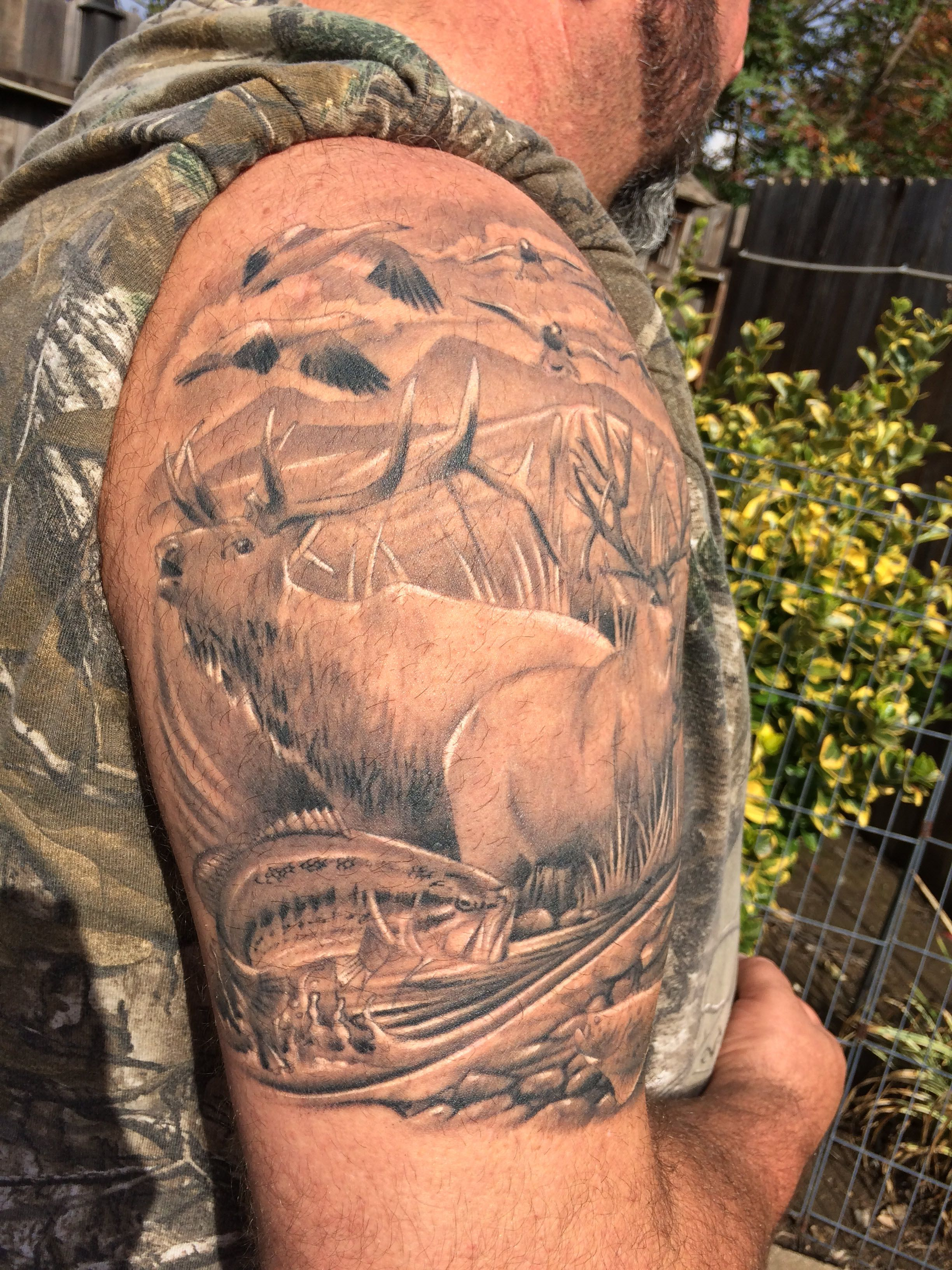 f836aa645 Wildlife Tattoo of geese flying by, bull elk, and a black bass jumping out  of the water
