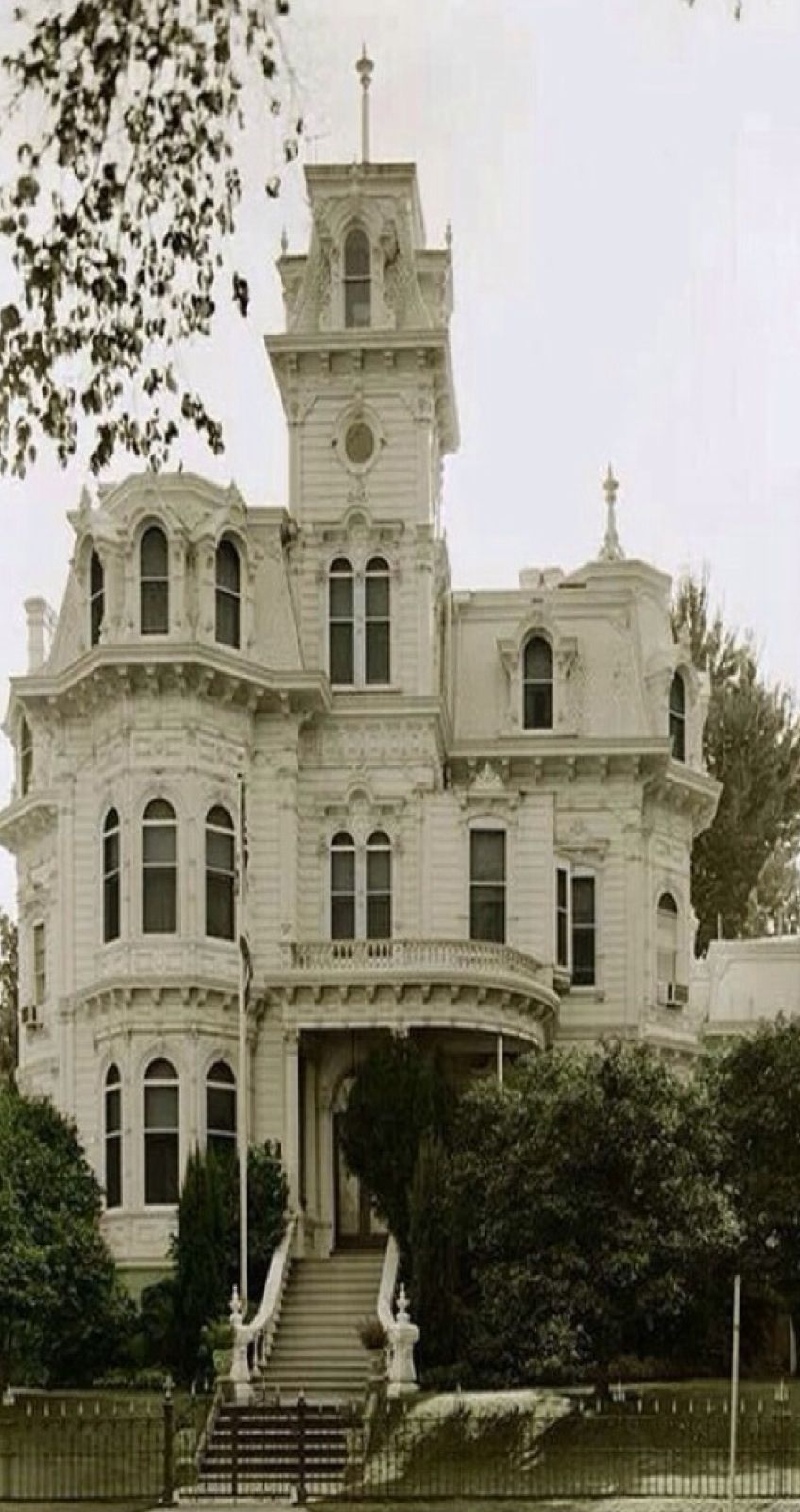 Victorian house with five stories, turret, cupola, and a widow's walk on fifth level ~