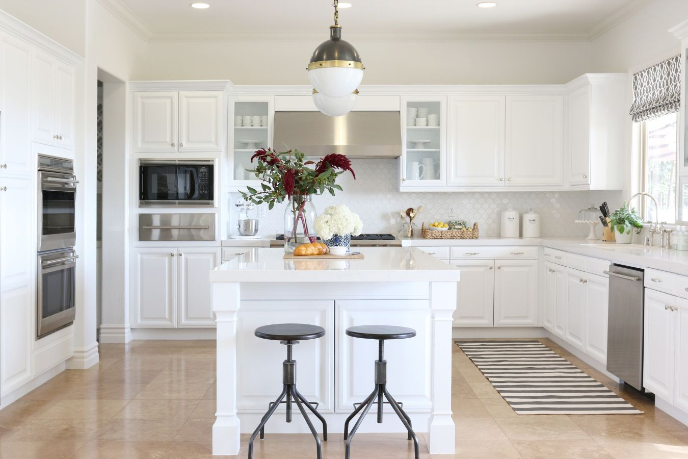 Seriously? This is definitely close to what heaven looks like. White kitchens in general make me abnormally happy, but this one is perfection designed by Studio McGee. It's a to-die-for combo of pretty patterned tile, fun lighting, and classic cabinetry. Don't miss one