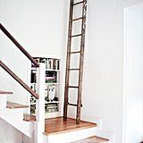 Leaning an old ladder against the wall is a brilliant way to fill unused space. Source: Photo by Tessa Neustadt for Homepolish