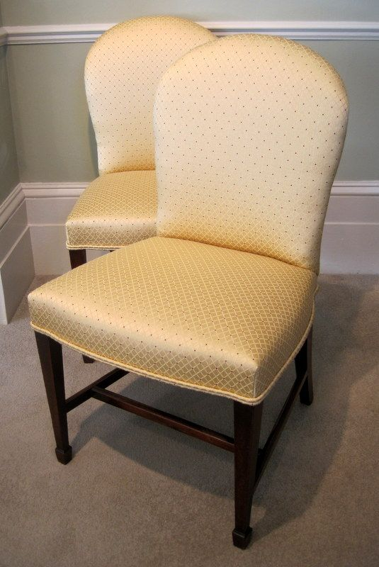 A fine pair of Hepplewhite period upholstered side chairs, with mahogany square tapering legs united by stretcher on spade feet. Circa 1790. RD.