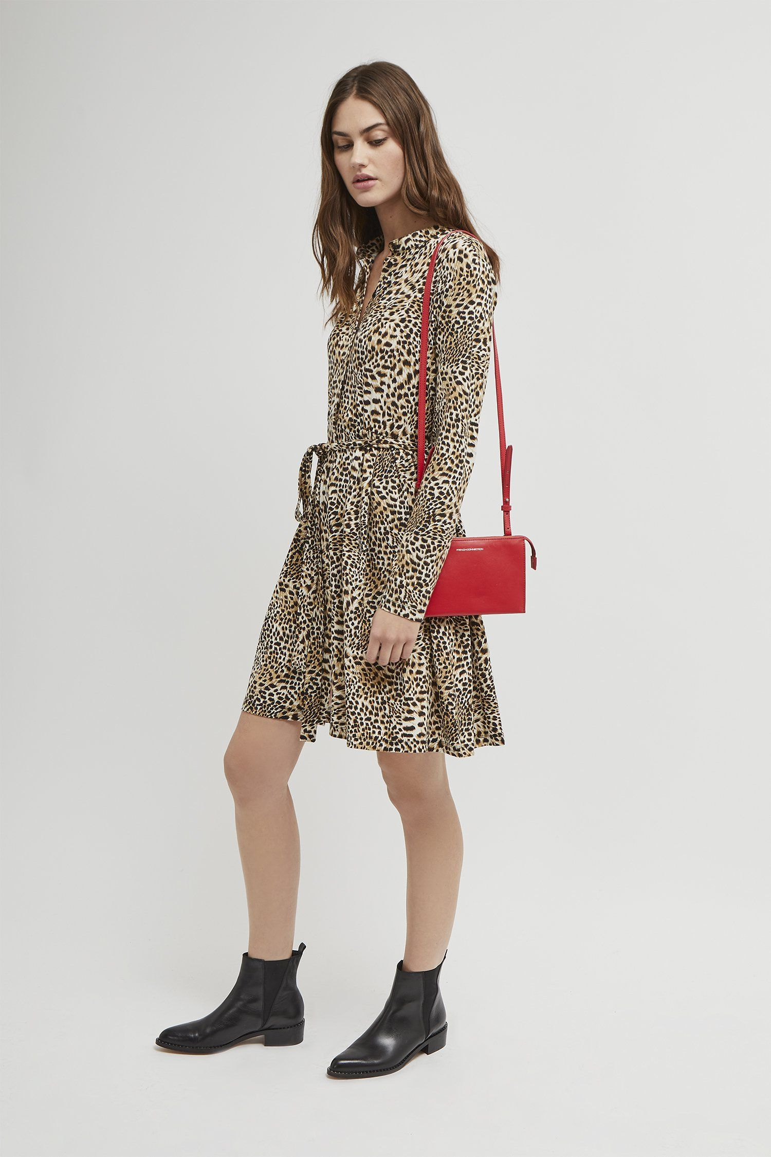 bc598eea1c4 <ul> <li> Leopard print shirt dress</li> <li> Fabric: soft, light,  smooth</li> <li> Button front</li> <li> Tie waist</li> <li> Long  sleeves</li> <li> ...