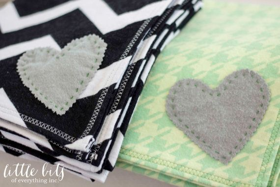 Set of Black, White, Gray and Green Receiving blankets for baby.