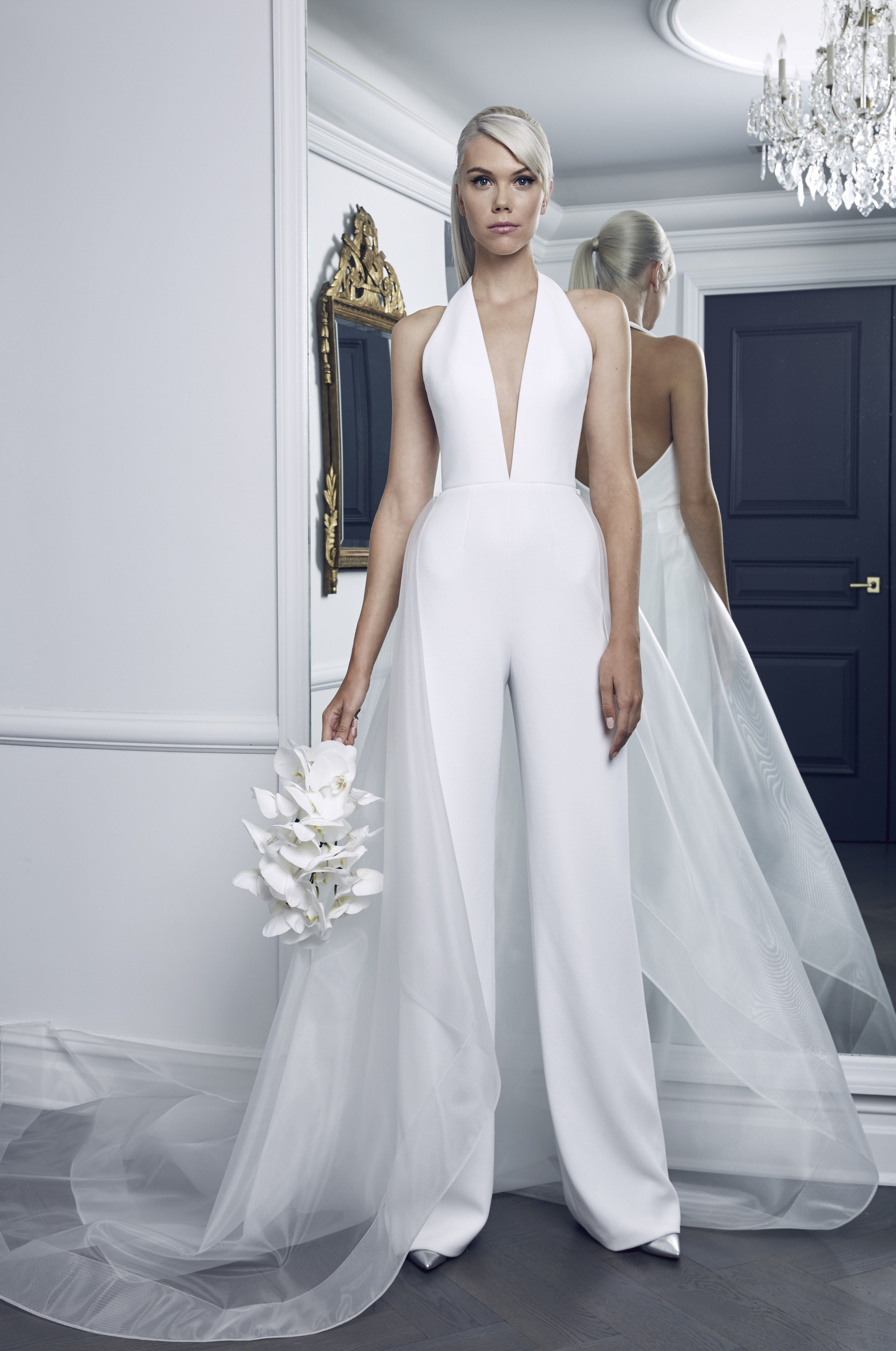 3fde90b4d08 A detachable transparent waist overlay helps this pearl stretch-crepe  jumpsuit feel more bridal. From the Romona Keveza Fall 2018 bridal  collection