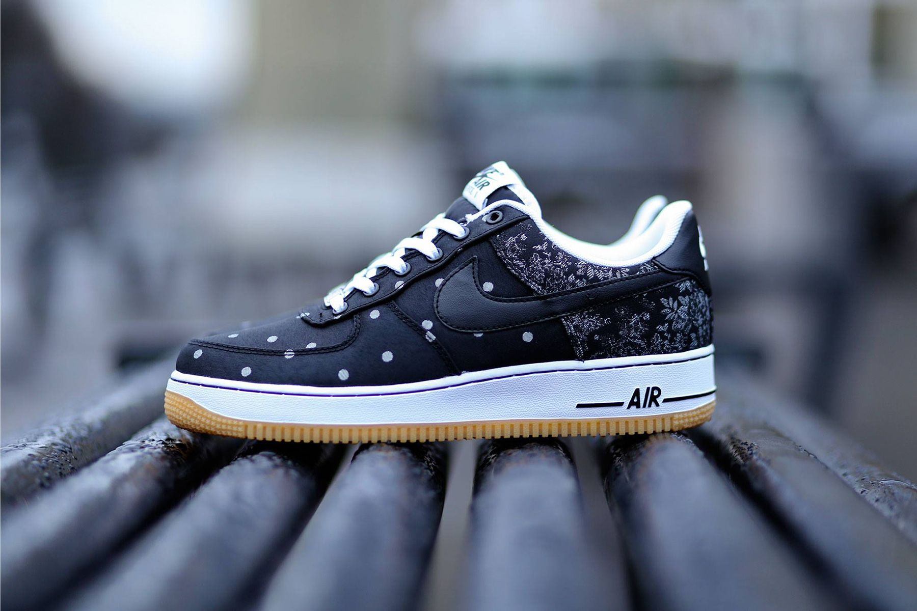 04f063bfda0f The Nike Air Force 1 LV8 sneaker combines two iconic prints on the new  edition. The shoe is dressed in a full black base on the upper with white  polka dots ...