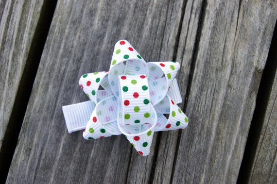 Christmas Present/Package Bow Hair Clip  Save yourself some time and put actual mini gift bows on your clip instead of making ribbon ones, looks adorable!