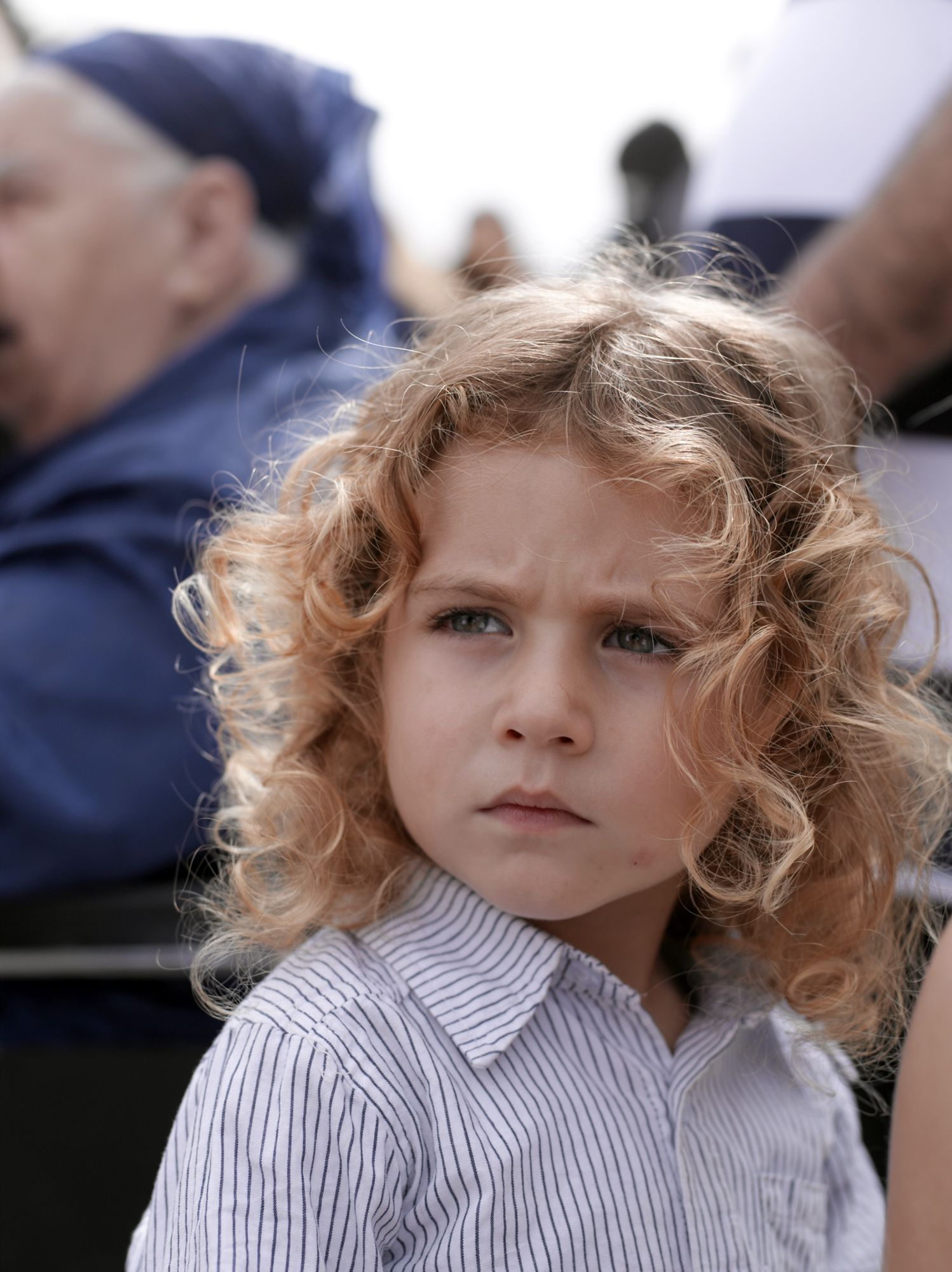 a young jewish israeli boy with long, uncut hair, 2012