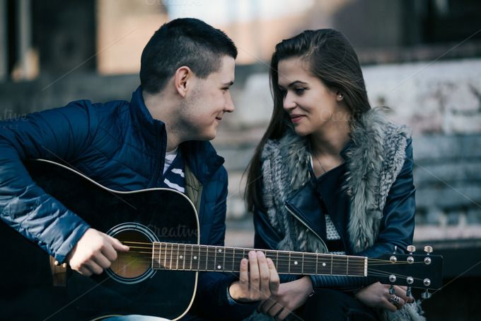 Teenage couple playing guitar by DJ Photography on @creativemarket