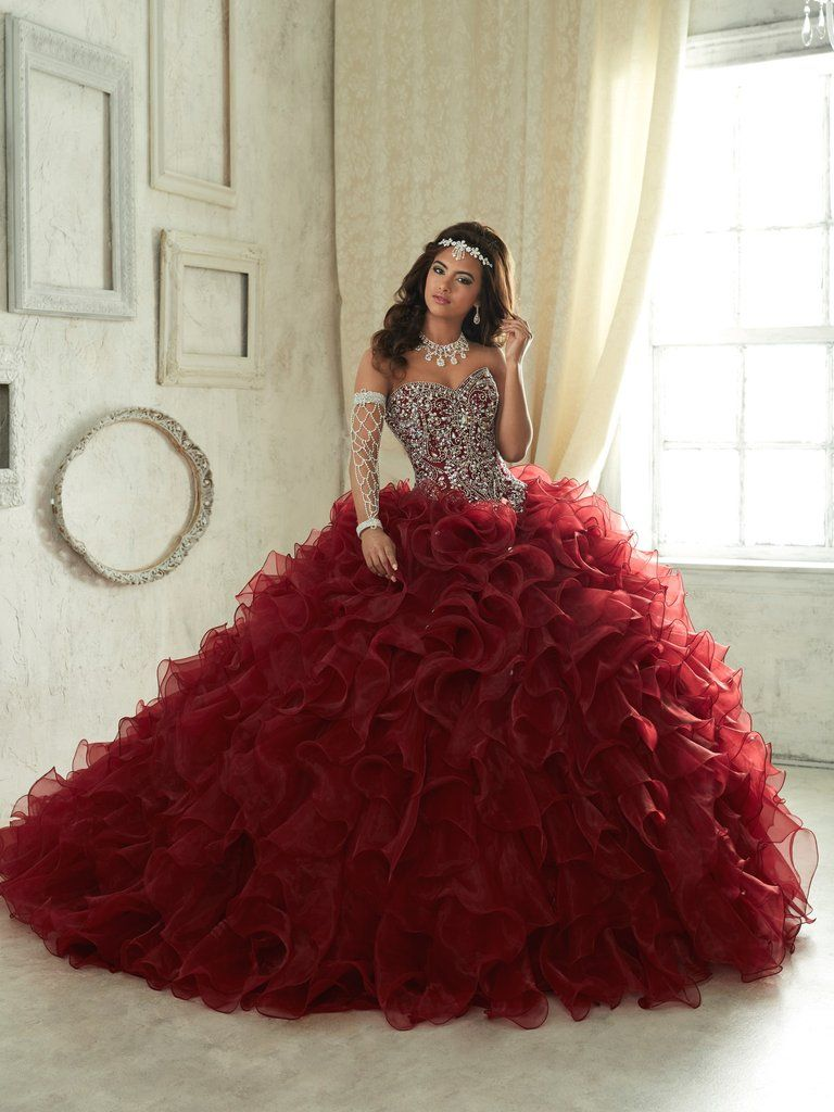 Make unforgettable memories in a House of Wu Quinceanera Dress Style Number 26833 during your Sweet 15 party or any formal event. The ball gown features a full, ruffled organza skirt with small rhines