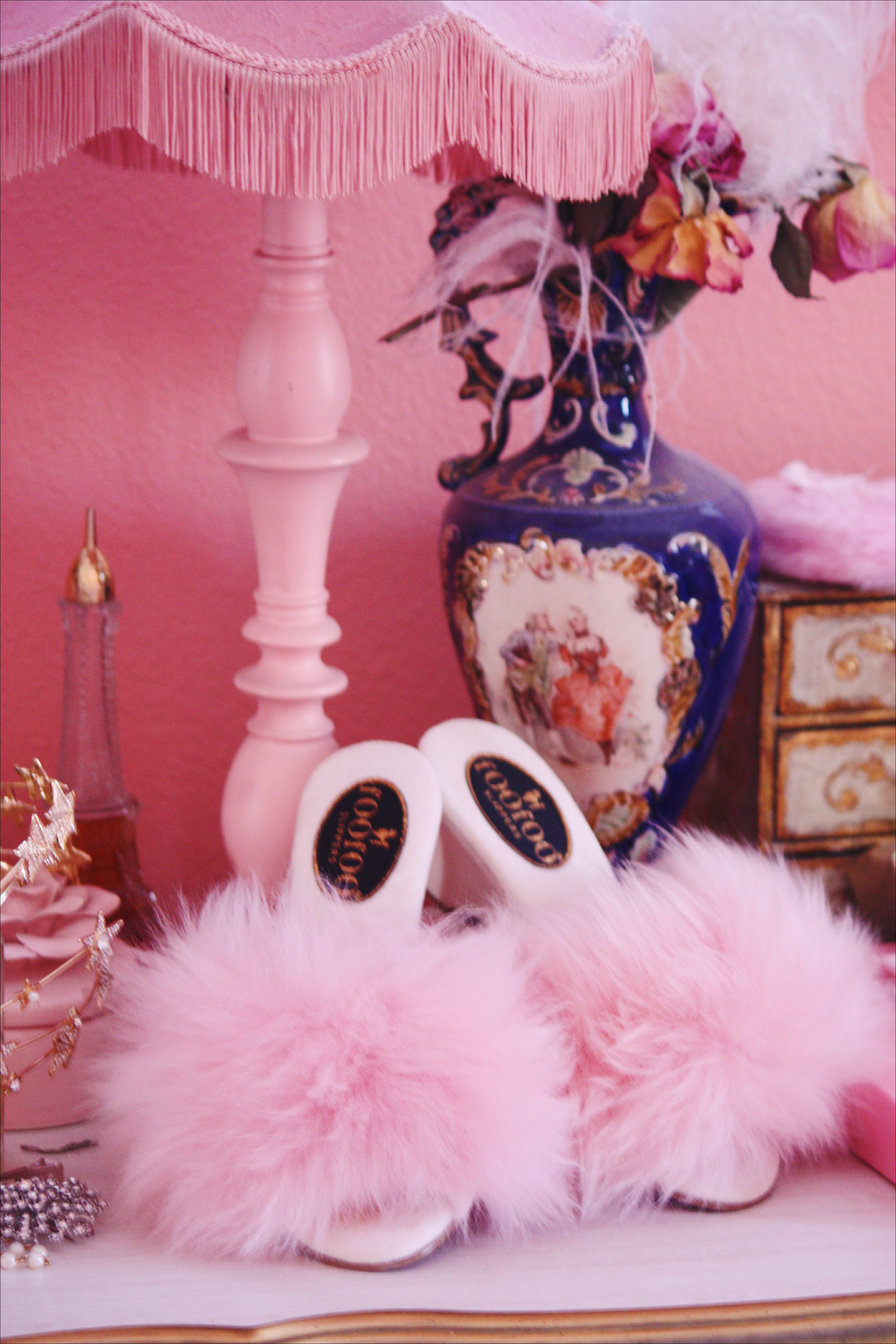A beautiful collaboration between fOOfOO Slippers & Tara and Ashlyn of the Pink Collar Life. The fOOfOOs shown are fluffy-heeled slippers with pink sheepskin upper and base. Every nuance of the shape and contours of the woman's foot must be taken into acc