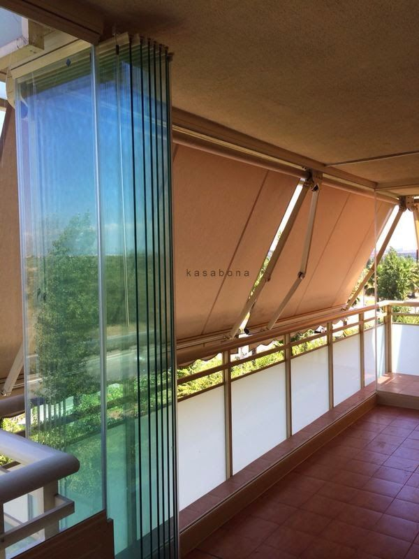 Kasabona cerramiento de terraza en salou con cortinas de for Cortinas para terrazas exteriores