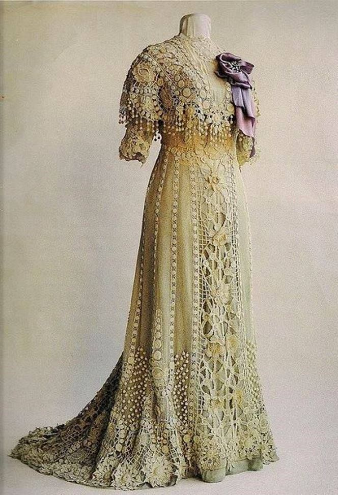 "via Embroiderer's Guild of Victoria: This elegant lace tea gown, ca.1900, features a purple / grey ombré underdress.  This beautiful Irish crocheted dress was worn by Anna Vidal I Sola de Rocamora around 1900.  The photo comes from Annie Potter's book, ""A Living Mystery, the International Art & History of Crochet"" and is courtesy of the Museo Textil y de Indumentaria at Museu del Disseny de Barcelona"