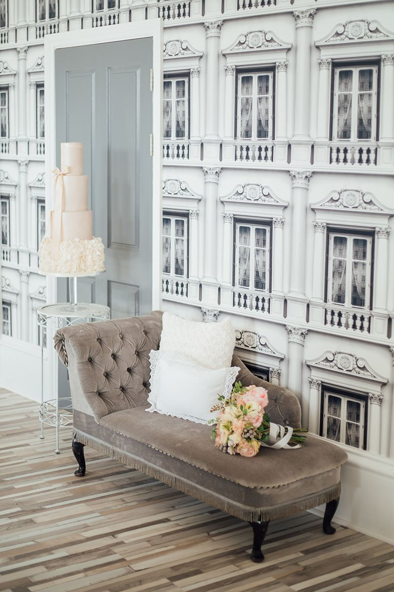 Blue grey chaise lounge and pink wedding chair. Posh hotel