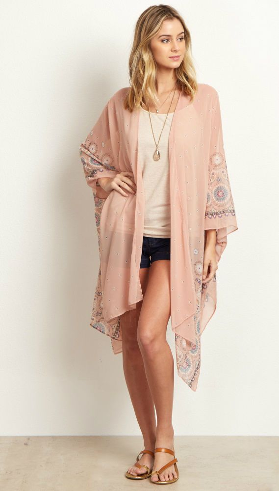 We are in love with this gorgeous kimono! A flowy chiffon material with a beautiful floral print border for a long kimono that will make a statement everywhere you go. Layer this kimono over a cami and wear with jeans and boots for a complete ensemble.