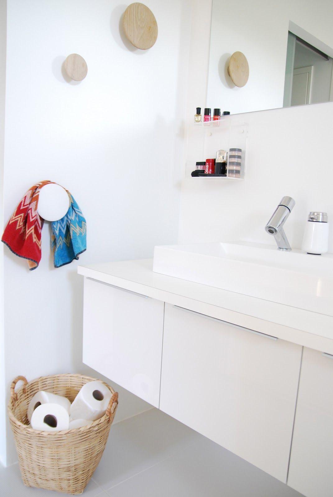 White Bathroom Laundry Storage via fargebarn | white bathroom | muuto dots | bathroom