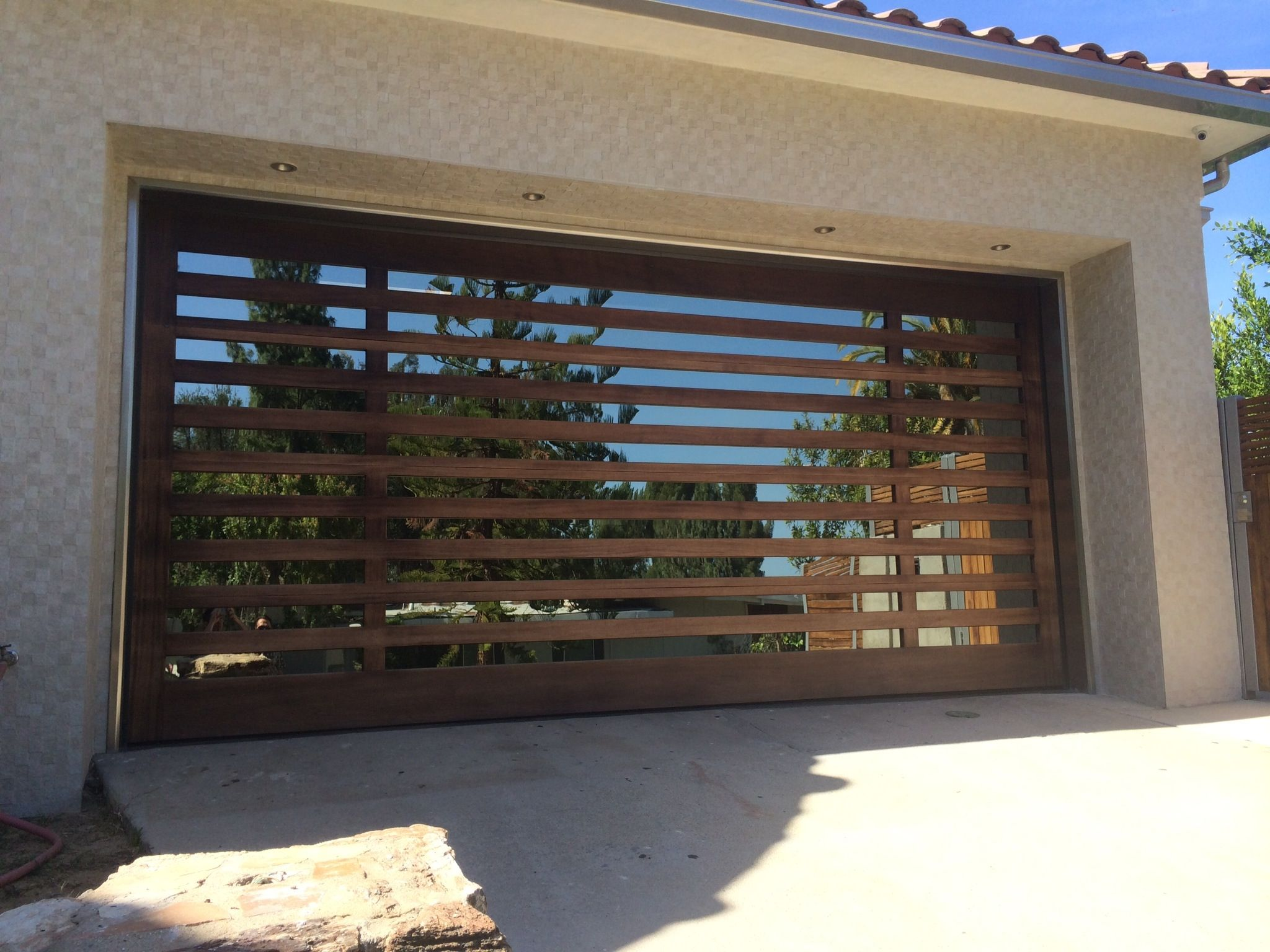 modern wood garage door. Brilliant Modern Garage Doors Design With Wooden And Glass Material Combined Concrete Wall In Cream Color Ideas Wood Door O