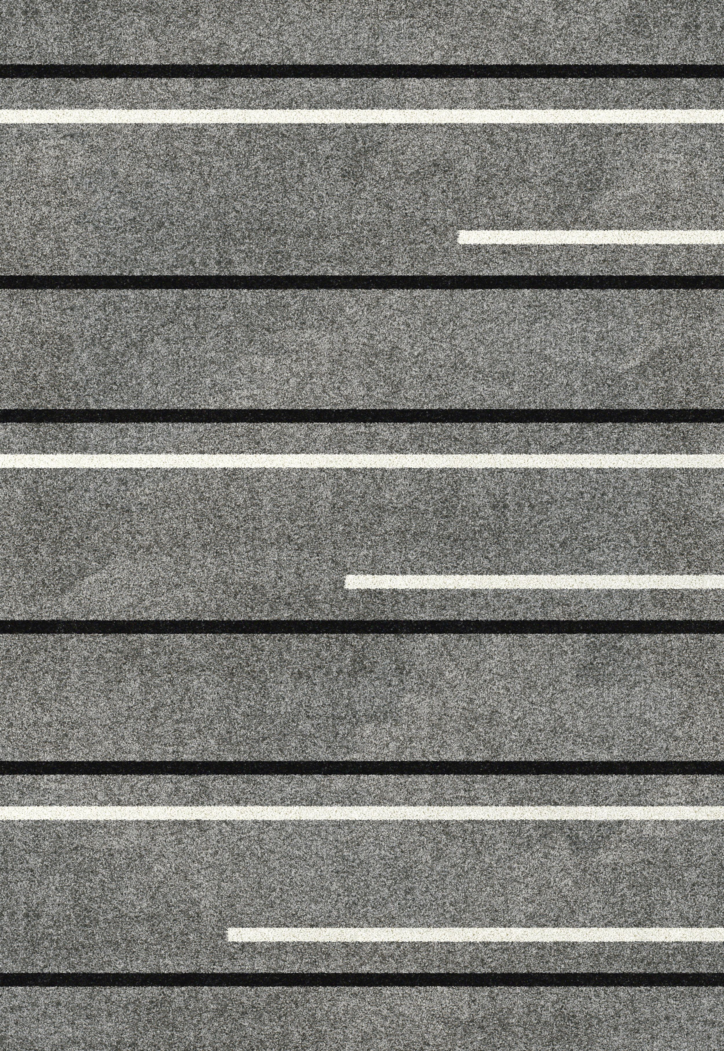 This Grey Area Rug Features A Striped Design In White And Black The Stripes Carry Across Entire Length Of Where As Are