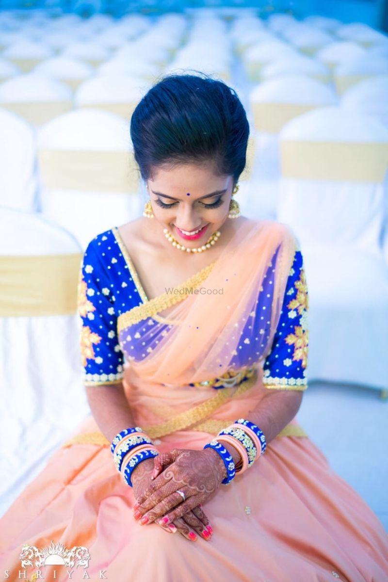 178e52cfe04c3c Bright blue blouse with peach tulle dupatta and lehenga! |  WedMeGood|#wedmegood #indianweddings #bridallehenga #peachlehenga  #indianweddingwear # ...