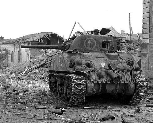 "A Canadian Sherman in the streets of Ortona, Italy. The battle was extremely fierce and it became known as 'Little Stalingrad on the Adriatic""."