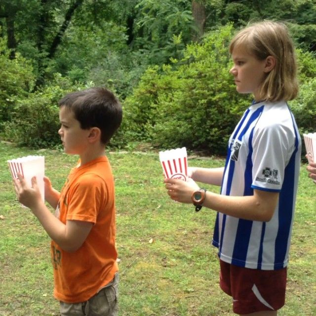 Fun, summertime game! Pass the water. Try it today click here for materials:  http://multitaskingmaven.com/how-to-play-pass-the-water/