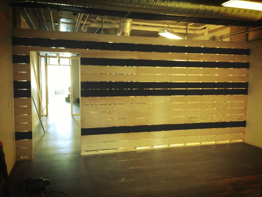 In Progress Construction photos: plywood divider wall. Designed by ...