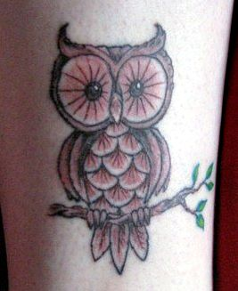 owl tattoo on branch